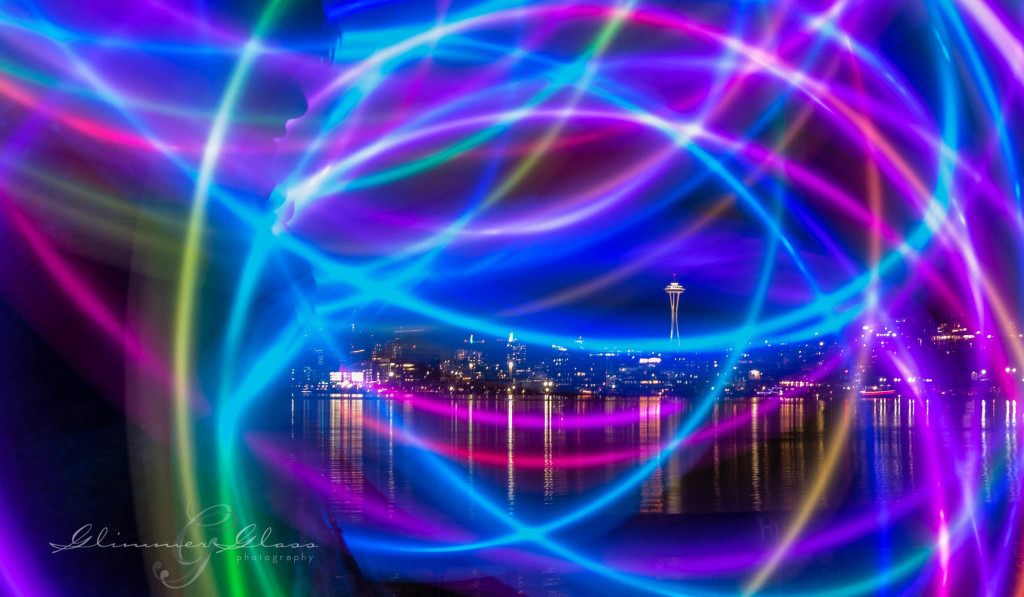 Brie swinging the Poi Pods at long exposure on the waterfront of Gasworks Park. New Year's Day, 2015